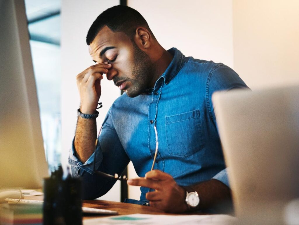 a man experiencing excessive sleepiness 7 Great Travel Tips On How To Stay Healthy While Traveling