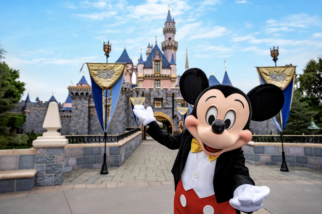 mickey disneyland sleeping beauty castle featured image large scaled 1 What to expect from Disney parks in 2021